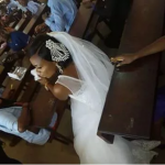Bride puts her wedding on hold to write her exam at the University - Photos
