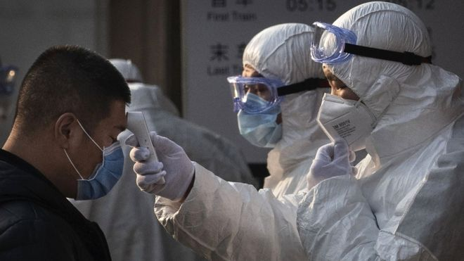 China locks down 400,000 people after virus spike near Beijing