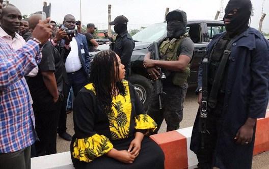 Armed men block entrance to Nigeria's parliament, minority leader quits