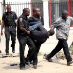 A man is arrested by the police for looting on the fourth day of a nationwide strike against the removal of the petrol subsidy in Lagos